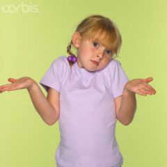 Girl Shrugging and Gesturing --- Image by © Burke/Triolo Productions/Brand X/Corbis